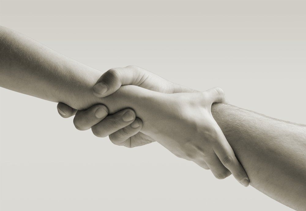 hold hands of your lovedone to help them overcome depression image